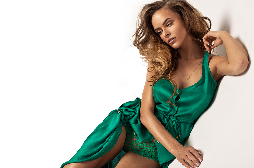 woman in emerald green silk dress and lace underwear